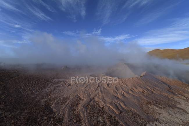 Hot spring with mud pools and steam of geyser field Sol de Manana, Altiplano, Bolivia, South America — Stockfoto