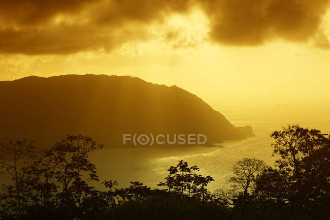 Sunset at Man-o-war Bay of Charlotteville, Tobago, Trinidad and Tobago, North America - foto de stock