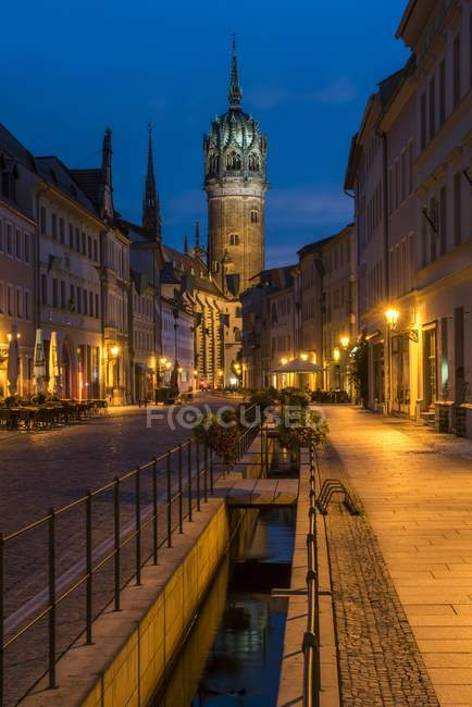Schlossstrasse with tower of castle church in evening atmosphere, Luther city Wittenberg, Saxony-Anhalt, Germany, Europe — Stock Photo
