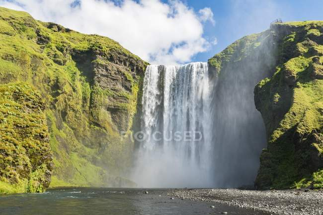 Low angle view of scenic waterfall Skogafoss, Iceland, Europe — Stock Photo