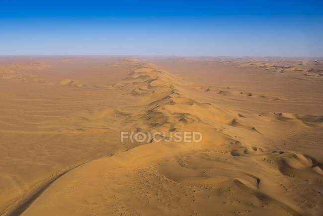 Aerial view of sand dunes chain in Namib desert, Erongo region, Namibia, Africa — стокове фото
