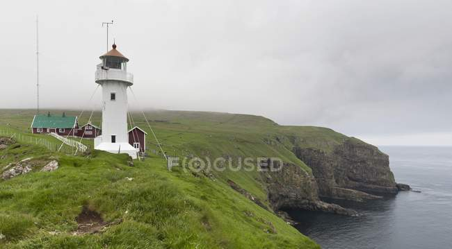 Lighthouse and cliffs of Akraberg at southernmost point of Suuroy, Faroe Islands, Denmark, Europe — Stock Photo