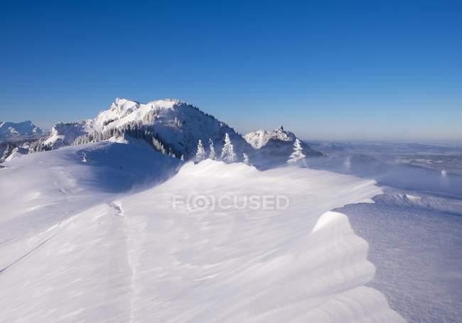 Windy snowdrifts on Brauneck summit, Latschenkopf and Stangeneck behind, Lenggries, Isarwinkel, Upper Bavaria, Bavaria, Germany, Europe — Stock Photo