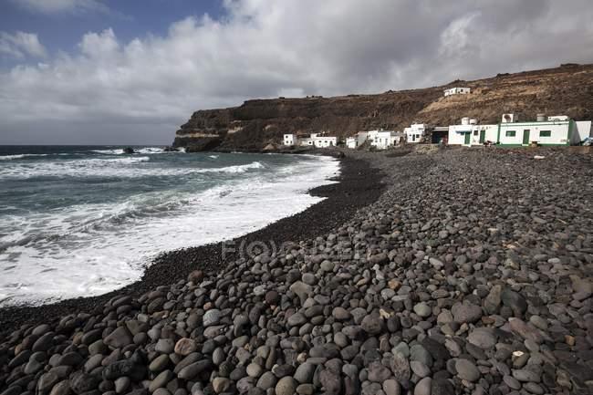 Lavafelsen am Strand, Los Molinos Fischerdorf auf dem Seeweg, Fuerteventura, Kanarische Inseln, Spanien, Europa — Stockfoto