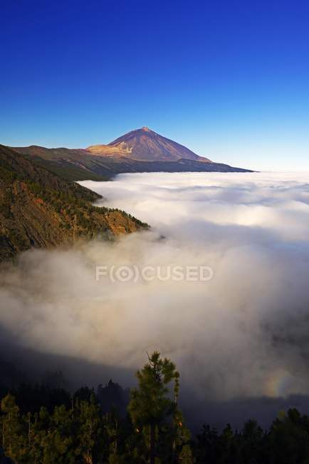 Pico del Teide at sunrise over trade wind clouds, Teide National Park, Tenerife, Canary Islands, Spain, Europe — Stock Photo