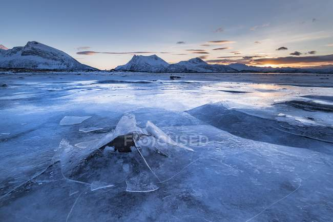 Frozen fjord with broken ice in wintry landscape, Gimsoy, Lofoten, Norway, Europe — Stock Photo