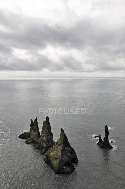 Reynisdrangar basalt sea stacks in ocean water, Vik, Iceland, Atlantic Ocean, Europe — Stock Photo