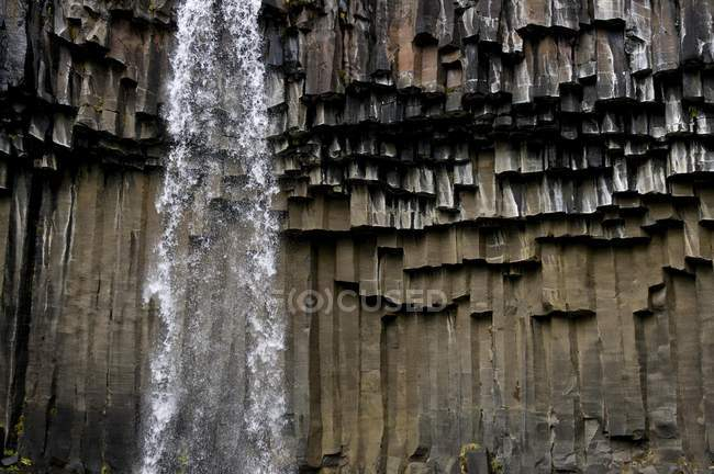 Waterfall with basalt columns in Skaftafell National Park, Iceland, Europe — Stock Photo