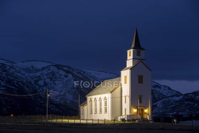 Illuminated church during blue hour, Brensholmen, Tromso, Norway, Europe — Stock Photo
