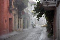 Observing view on city street in heavy rain — Stock Photo