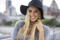Stylish blonde girl with hat — Stock Photo