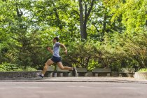 Athletic man running — Stock Photo