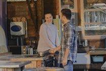 Couple using stove top — Stock Photo