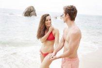 Couple walking on beach — Stock Photo
