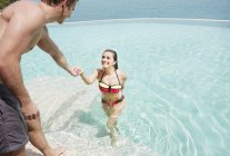 Couple getting out of swimming pool — Stock Photo