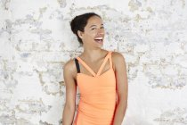 Woman in sportswear laughing at camera — Stock Photo