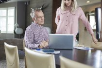 Couple working at home together — Stock Photo