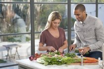 Couple preparing food together — Stock Photo