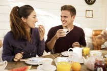 Couple eating breakfast together — Stock Photo