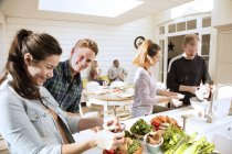 Couples preparing food together — Stock Photo