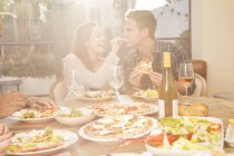Couple eating pizza and salad — Stock Photo