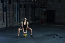 Woman exercising with kettlebell — Stock Photo