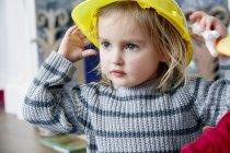 Girl wearing yellow helmet — Stock Photo
