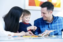 Parents and son playing with toys — Stock Photo