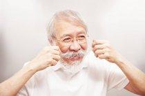 Man twirling moustache — Stock Photo