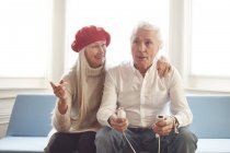 Senior couple playing video games — Stock Photo