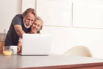 Senior couple enjoying video conference — Stock Photo