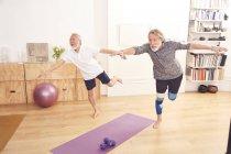Senior men doing yoga together — Stock Photo