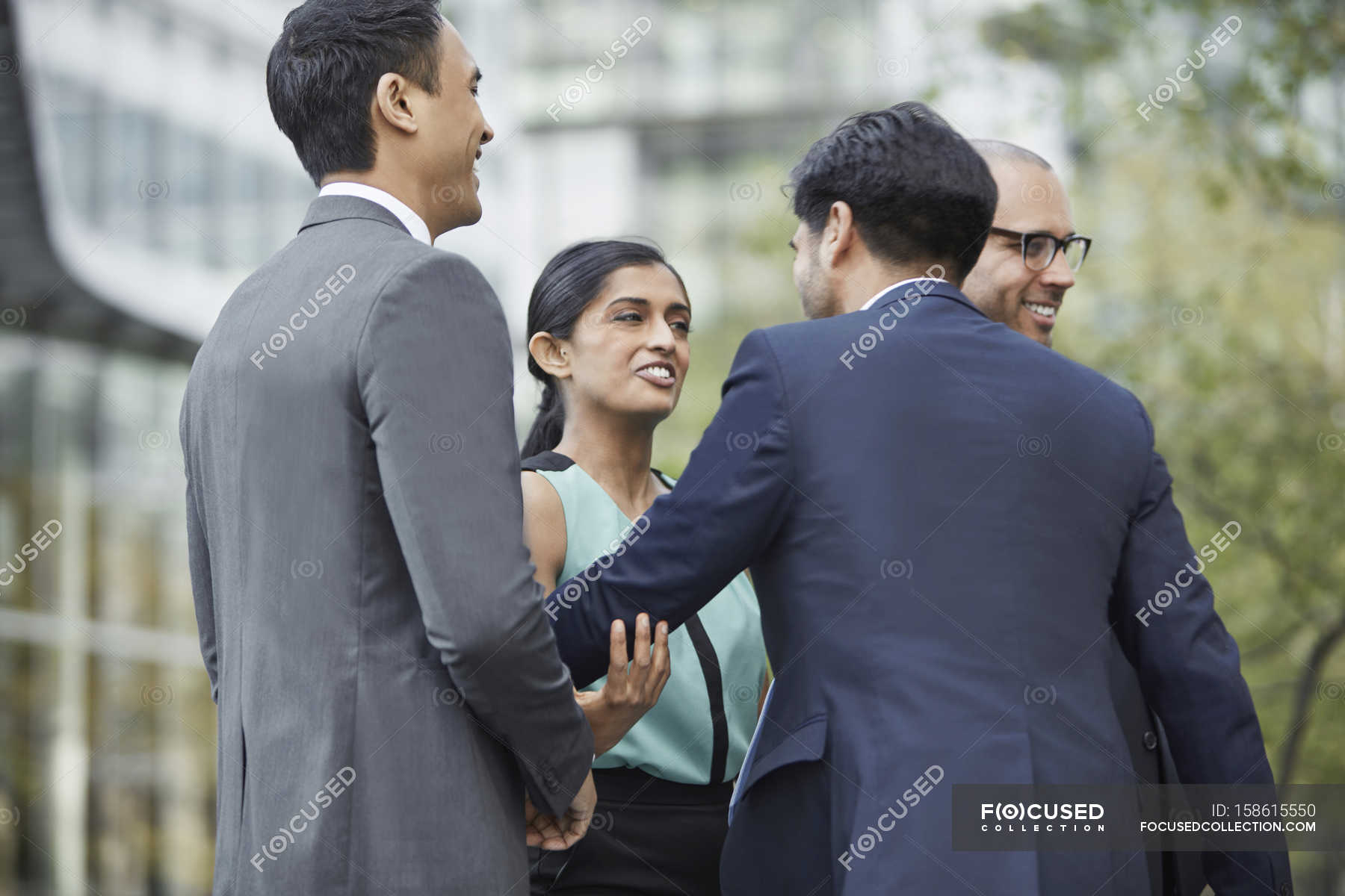 Businesspeople Greeting Each Other Stock Photo 158615550