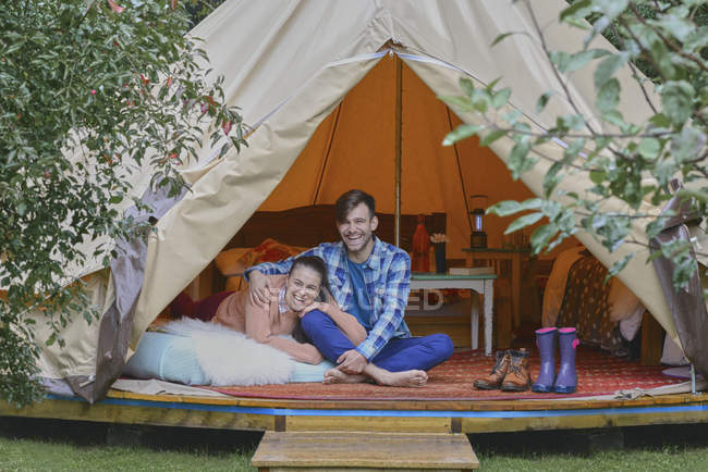 Couple sitting in tent together — Stock Photo