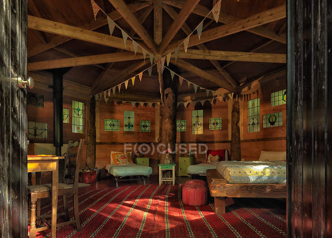 Bedroom with pennant flags in cabin — Stock Photo
