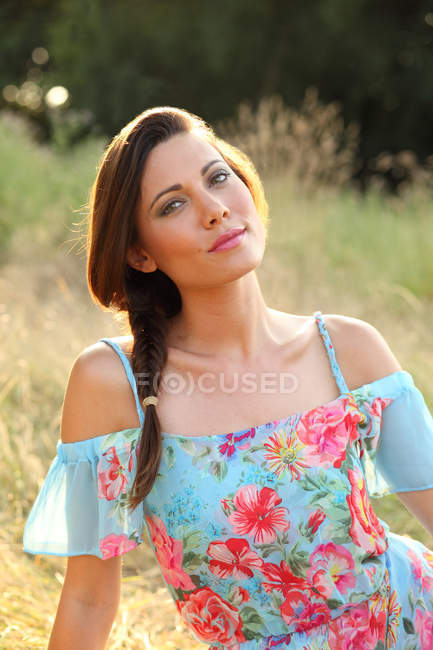 Woman in blue dress posing for camera — Stock Photo