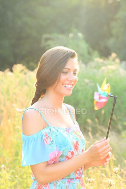 Woman in dress holding pinwheel toy — Stock Photo