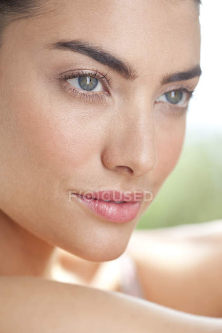 Close up portrait of woman looking away — Stock Photo