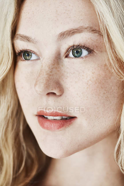 Woman with freckles looking away — Stock Photo