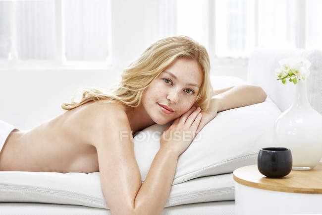 Woman lying on front and smiling — Stock Photo