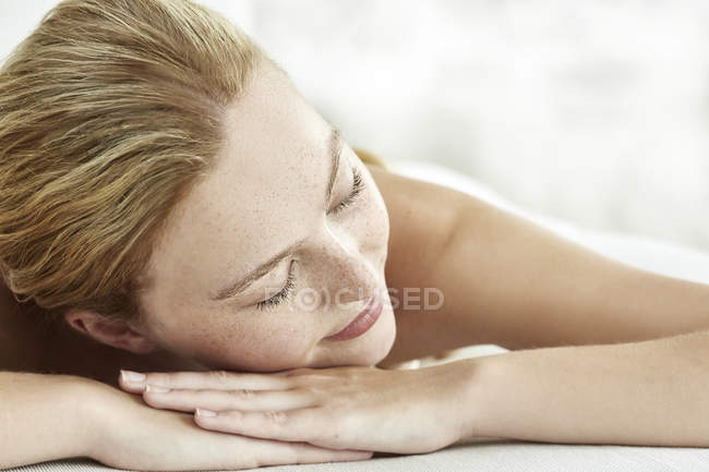 Woman smiling with eyes closed — Stock Photo