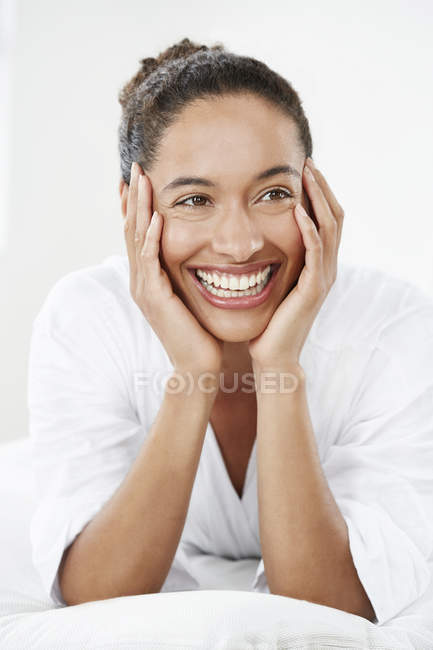 Woman with hands touching face — Stock Photo