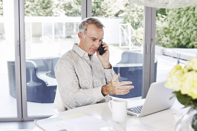 Man working with laptop from home — Stock Photo