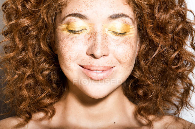 Woman with closed eyes and freckles on face — Stock Photo