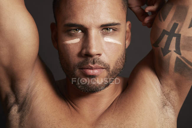 Man wearing face cream — Stock Photo