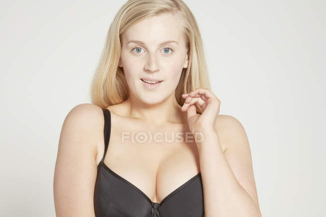 Model in black bra looking at camera — Stock Photo