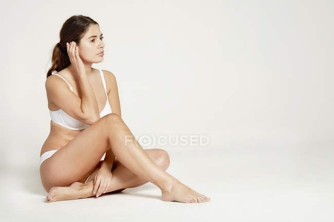Female model posing in white underwear — Stock Photo