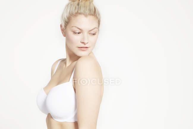 Model posing in white bra — Stock Photo