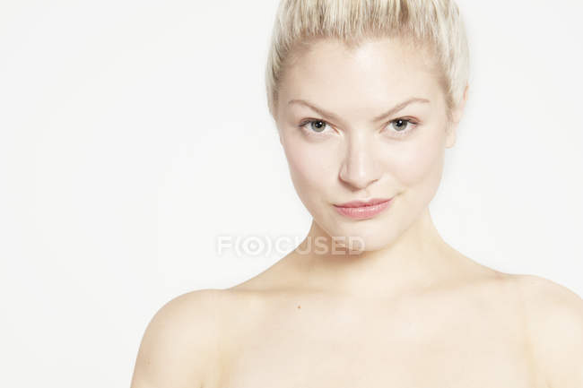 Model with bare shoulders and hair bun — Stock Photo