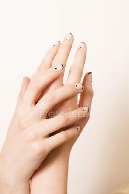 Woman displaying nail polish — Stock Photo